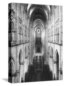 Amiens Cathedral Showing High Vaulted Arches, Rose Window in Distance, Sublime Gothic Expression by Nat Farbman