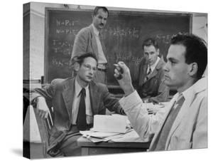 Atomic Scientists Discussing Subatomic Particles by Nat Farbman