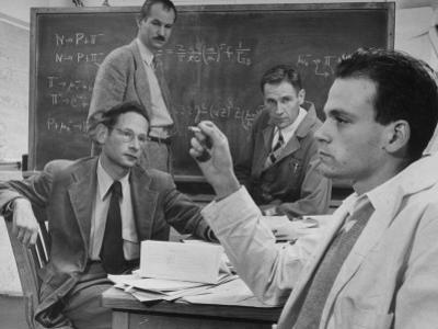 Atomic Scientists Discussing Subatomic Particles
