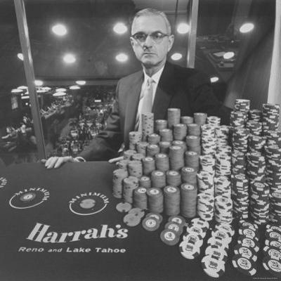 Casino and Night Club Owner William Harrah at Table by Nat Farbman