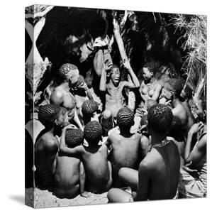 Chief Acts Out a Story to Bushman Children, Southern Kalahari Desert in Central Southern Africa by Nat Farbman