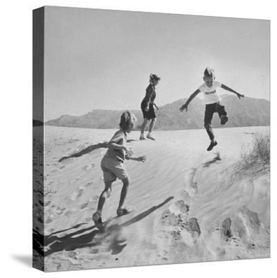 Children Playing in the Desert Sand