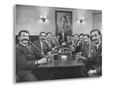 Members of Handlebar Club Sitting at Table and Having Formal Beer Session