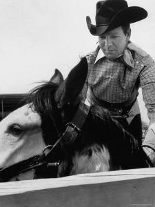 Rodeo Star Casey Tibbs Sitting in the Pen at a Rodeo Just Before His Horse Threw Him by Nat Farbman