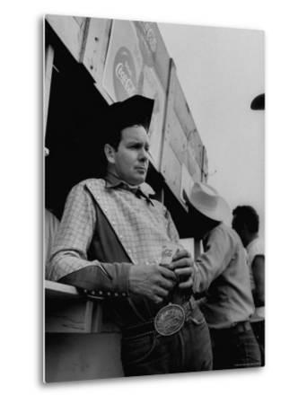 Rodeo Star Casey Tibbs Standing at a Rodeo by Nat Farbman