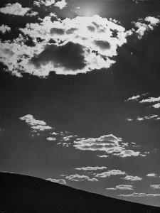 Sunshine Filled Clouds Against Dark Sky, Above Dark Dune in Middle of Kalahan Desert, Bechuanaland by Nat Farbman