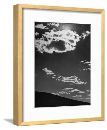 Sunshine Filled Clouds Against Dark Sky, Above Dark Dune in Middle of Kalahan Desert, Bechuanaland