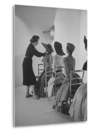 Vogue Magazine Editor Bettina Ballard Directing and prepping models for Photo Shoot at Studio by Nat Farbman