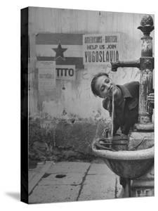 Young Boy Getting a Drink from Fountain in Trieste Region by Nat Farbman