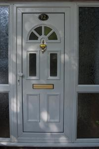A White Front Door of a Residential House by Natalie Tepper