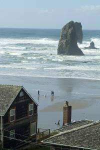 Cannon Beach, Oregon. People Walking with Dog by Natalie Tepper
