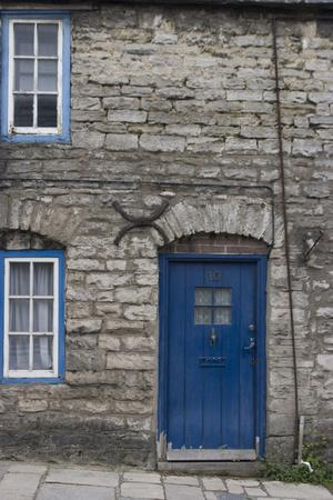 Door and Windows in Front of a Traditional Stone Cottage in Village of Corfe Castle Dorset Uk