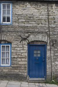 Door and Windows in Front of a Traditional Stone Cottage in Village of Corfe Castle Dorset Uk by Natalie Tepper