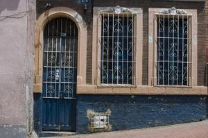 Doorway and Window with Grille in La Candelaria (Old Section of the City), Bogota, Colombia by Natalie Tepper
