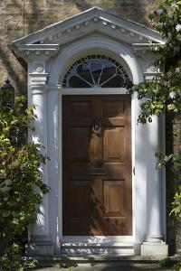 Entrance into a House with Grand Door with Window Lights, Surrounded by Vegetation by Natalie Tepper