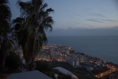 Night View over Funchal, Madeira, Portugal. Building Illuminated and Water in the Background by Natalie Tepper