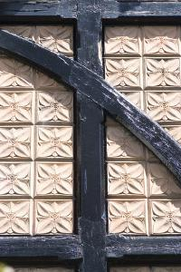 Plaster Patterned Tiles in a Wood Timber Frame, on a Residential Building by Natalie Tepper
