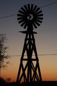 Silhouette of a Traditional Windmill at Sunset, Amarillo, Texas, Usa by Natalie Tepper