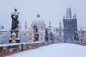 Snow Morning at Charles Bridge in Winter, Prague, Czech Republic by Nataliya Hora