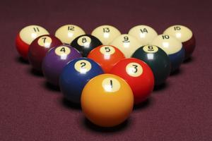Fifteen Billiard Balls Arranged in Triangle on Pool Table by Nathan Allred