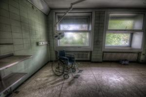 Wheelchair in Empty Room by Nathan Wright