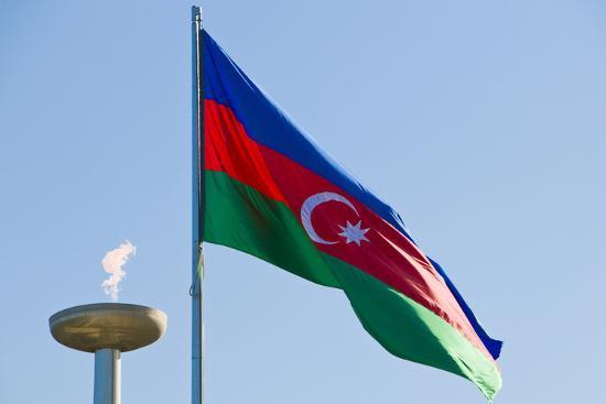 National Flag Blowing in Wind, Baku, Azerbaijan-Michael Runkel-Photographic Print