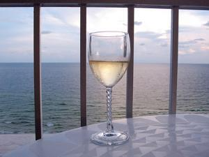 A Glass of White Wine on the Balcony of a Condo at Gulf Shores by National Geographic Photographer