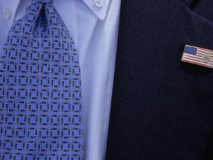 Tie and Lapel Pin on a Secret Service Agent Guarding President Bush by National Geographic Photographer