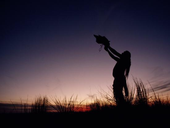 Native North American Holding an Artifact Up Towards the Sky-Chris Johns-Photographic Print