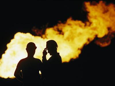 Natural Gas Workers Silhouetted by Burning Dross-George F^ Mobley-Photographic Print