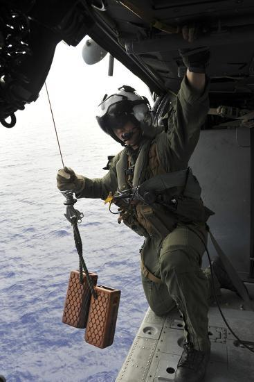 Naval Aircrewman Conducts a Search and Rescue Drill on an Mh-60S Sea Hawk--Photographic Print