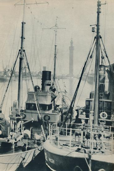 'Naval Trawler, HMS Liffy alongside a Grimsby fishing vessel in Grimsby Docks', 1937-Unknown-Photographic Print