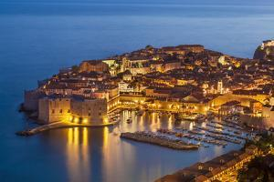 Aerial view of Old Port and Dubrovnik Old Town at night, UNESCO World Heritage Site, Dubrovnik, Dal by Neale Clark