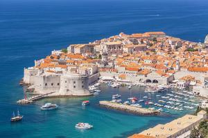 Aerial view of Old Port and Dubrovnik Old town, UNESCO World Heritage Site, Dubrovnik, Dalmatian Co by Neale Clark