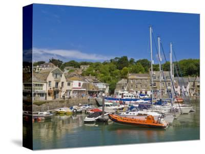 Busy Tourist Shops, Small Boats and Yachts at High Tide in Padstow Harbour, North Cornwall, England