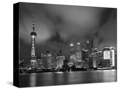 City Skyline at Night with Oriental Pearl Tower and Pudong Skyscrapers across the Huangpu River, Sh