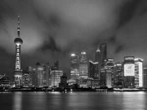 City Skyline at Night with Oriental Pearl Tower and Pudong Skyscrapers across the Huangpu River, Sh by Neale Clark
