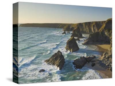 Evening Light on Rock Stacks, Beach and Rugged Coastline, Bedruthan Steps, North Cornwall, England