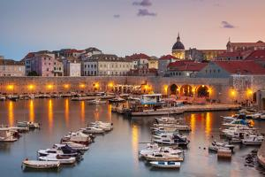 Fishing boats at sunset in the Old Port, Dubrovnik Old Town, UNESCO World Heritage Site, Dubrovnik, by Neale Clark