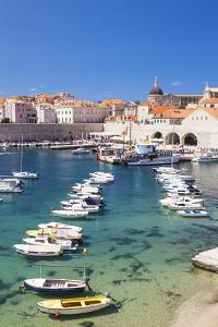 Fishing boats in the Old Port, Dubrovnik Old Town, UNESCO World Heritage Site, Dubrovnik, Dalmatian by Neale Clark