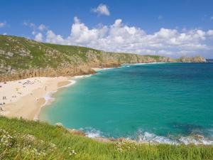 Holidaymakers and Tourists Sunbathing on Porthcurno Beach, Cornwall, England, United Kingdom by Neale Clark