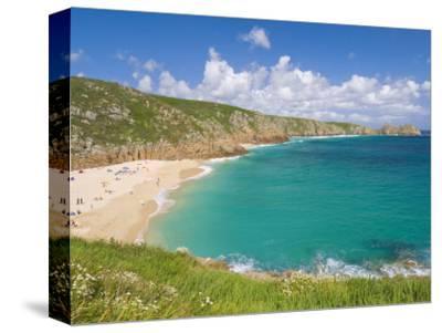 Holidaymakers and Tourists Sunbathing on Porthcurno Beach, Cornwall, England, United Kingdom