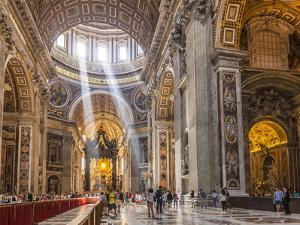 Interior of St. Peters Basilica with Light Shafts Coming Through the Dome Roof, Vatican City by Neale Clark