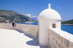 Old City walls and view of coast, Dubrovnik Old Town, UNESCO World Heritage Site, Dubrovnik, Dalmat by Neale Clark