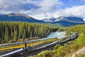 Rocky Mountaineer Train at Morant's Curve Near Lake Louise in the Canadian Rockies by Neale Clark