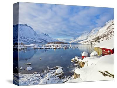 Snow Covered Mountains, Boathouse and Moorings in Norwegian Fjord Village of Ersfjord, Kvaloya Isla