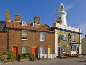 Sole Bay Inn Pub with Southwold Lighthouse Behind, Southwold, Suffolk, England, United Kingdom by Neale Clark