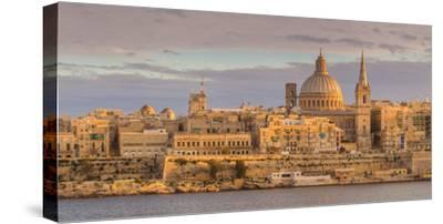 Valletta Skyline Panorama at Sunset with the Carmelite Church Dome and St. Pauls Anglican Cathedral