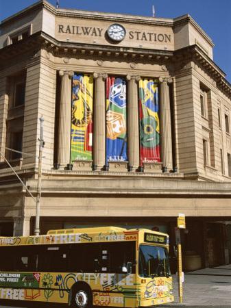 Bus Passing the Railway Station, Adelaide, South Australia, Australia by Neale Clarke