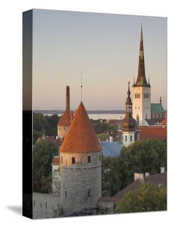 Medieval Town Walls and Spire of St. Olav's Church at Dusk, Tallinn, Estonia, Baltic States